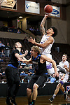 SIOUX FALLS, SD - MARCH 12:  Keun Palu-Thompson #2 from the College of Idaho takes the ball to the basket over Derek Hinen #34 from St. Francis during their semifinal game at the 2018 NAIA DII Men's Basketball Championship at the Sanford Pentagon in Sioux Falls. (Photo by Dave Eggen/Inertia)