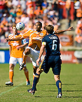 Houston Dynamo midfielder Ricardo Clark (13) attempts to pass the ball away from Los Angeles Galaxy midfielder Eddie Lewis (6). Houston Dynamo tied Los Angeles Galaxy 0-0 at Robertson Stadium in Houston, TX on October 18, 2009.