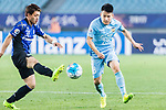 Gamba Osaka Midfielder Doan Ritsu (L) fights for the ball with Jiangsu FC Midfielder Yang Xiaotian (R) during the AFC Champions League 2017 Group H match between Jiangsu FC (CHN) vs vs Gamba Osaka (JPN) at the Nanjing Olympics Sports Center on 11 April 2017 in Nanjing, China. Photo by Yu Chun Christopher Wong / Power Sport Images