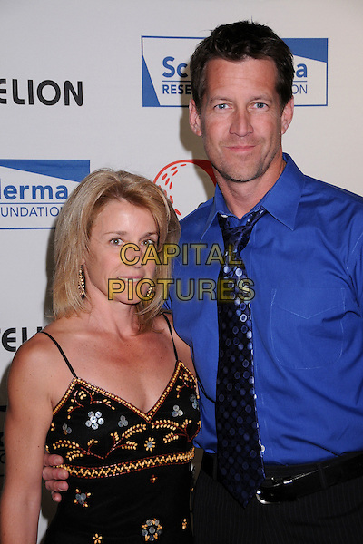 "ERIN & JAMES DENTON.Scleroderma Research Foundation?s ""Cool Comedy - Hot Cuisine"" 2008 at the Four Seasons Beverly Wilshire Hotel, Beverly Hills, California, USA..April 16th, 2008.half length blue shirt tie polka dot black dress married husband wife .CAP/ADM/BP.©Byron Purvis/AdMedia/Capital Pictures."