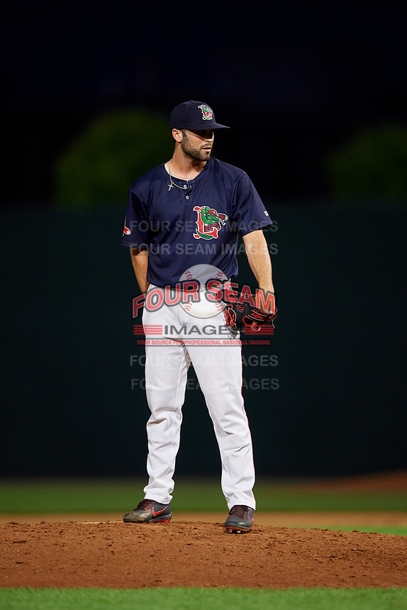 Lowell Spinners relief pitcher Andrew Politi (63) looks in for the sign during a game against the Vermont Lake Monsters on August 25, 2018 at Edward A. LeLacheur Park in Lowell, Massachusetts.  Vermont defeated Lowell 4-3.  (Mike Janes/Four Seam Images)