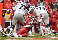 NWA Media/Michael Woods --11/22/2014-- w @NWAMICHAELW...University of Arkansas defender Martrell Spaight makes the hit on Ole Miss running back I'Tavius Mathers as he tries to get out of the end zone in the 1st quarter of Arkansas 30-0 win over Ole Miss during Saturdays game at Razorback Stadium.