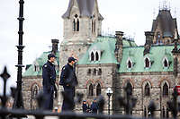 Ottawa - CANADA - October 23, 2014 - Policemen, soldiers and members of the public gather near the sites of the attacks by 32-year-old radicalized shooter Michael Joseph Zehaf-Bibeau,  one day after the events.<br /> <br /> Photo : Agence Quebec Presse - Nick Lafontaine