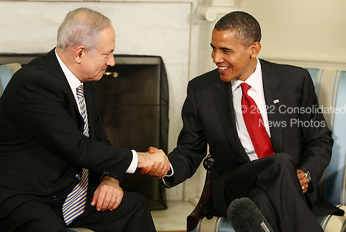 United States President Barack Obama (R) shakes hands with Prime Pinister Benjamin Netanyahu of Israel (L) during a meeting in the Oval Office at the White House on Tuesday, July 6, 2010 in Washington, DC. The two leaders spoke to reporters and are scheduled to participate in a working lunch.  .Credit: Mark Wilson - Pool via CNP