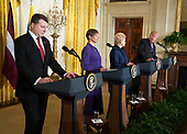 United States President Donald J. Trump participates in a news briefing with President Raimonds Vejonis of Latvia(L),  President Kersti Kaljulaid of Estonia(2nd L) and President Dalia Grybauskaite of Lithuania(2nd R) at The White House in Washington, DC, April 3, 2018. <br /> Credit: Chris Kleponis / Pool via CNP