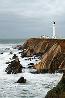 The Point Arena Lighthouse stands sentinel on the Northern California Coast, south of Mendocino, as a winter storm approaches in January of 2008. The original Point Arena Lighthouse was damaged in the 1906 Earthquake the United States Lighthouse Service contracted with a San Francisco based company that built factory smokestacks to build a replacement. The new Point Arena Lighthouse began operation in 1908 and was the first lighthouse to be built with steel reinforcement rods encased in concrete to help it withstand an earthquake. Photographed 01/08