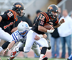 SIOUX FALLS, SD - OCTOBER 16:  Chayden Fitzsimmons #22 from Washington tries to break the grasp of Devon Adams #86 from Rapid City Stevens in the first half of their game Friday night at Howard Wood Field. (Photo by Dave Eggen/Inertia)