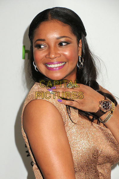 """Tamala Jones.PaleyFest 2012 Presents """"Castle"""" held at The Saban Theatre, Beverly Hills, California, USA, 9th March 2012..portrait headshot smiling pink lipstick  gold hand ring  nails purple nail varnish polish .CAP/ADM/BP.©Byron Purvis/AdMedia/Capital Pictures."""
