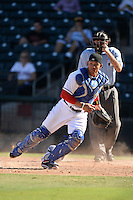 Surprise Saguaros catcher Jorge Alfaro (22), of the Texas Rangers organization, looks for the ball as umpire Pat Hoberg looks on during an Arizona Fall League game against the Scottsdale Scorpions on October 17, 2013 at Surprise Stadium in Surprise, Arizona.  Surprise defeated Scottsdale 10-5.  (Mike Janes/Four Seam Images)
