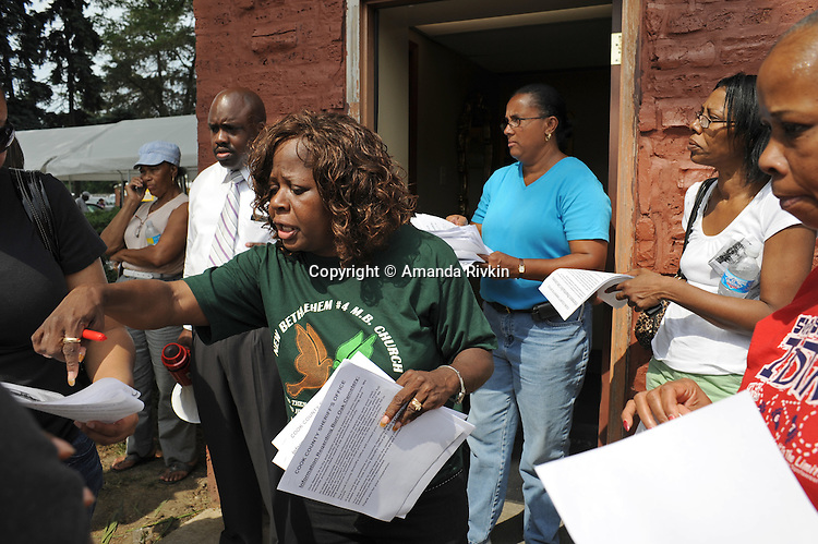 (Center) Joyce Mattox, a volunteer from Calumet Park, Illinois assists families who are trying to find out the location of relatives who were buried before 2001 near the entrance to the Burr Oak Cemetery, one of the oldest and most historic black American cemeteries on the outskirts of Cook County, the same day four cemetery managers and caretakers were arrested on felony charges of disinterring and dismembering bodies at the cemetery in order to resell the plots to unsuspecting members of the public in Alsip, Illinois on July 9, 2009. In recent months, many older graves had reportedly been moved and relocated within the cemetery grounds adding to the forensics confusion.