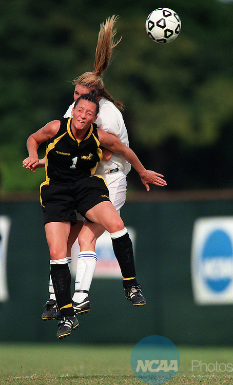 02 DEC 2000:  Forward Jeanna Martin (1) of Northern Kentucky skies for a header against midfielder Laura Dooly (4) of UCSD during the Division 2 Women's Soccer Championship held at Buccaneer Field on the Barry University campus in Miami Shores, FL.  The University of California at San Diego defeated Northern Kentucky 2-1 for the national title.  Bill Ingram/NCAA Photos