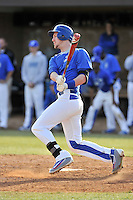 Right fielder Kep Brown (24) of the Spartanburg Methodist College Pioneers hits an RBI double in a junior college game against Surry Community College on January 31, 2016, at Mooneyham Field in Spartanburg, South Carolina. (Tom Priddy/Four Seam Images)