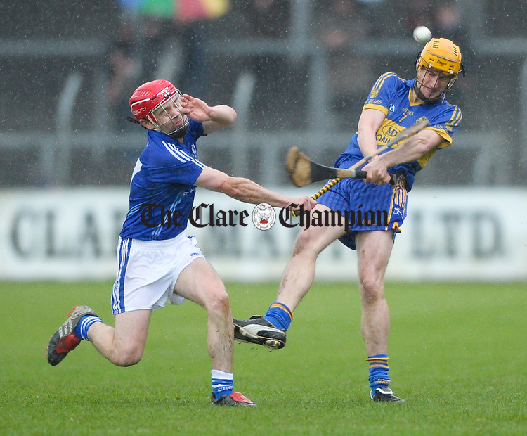 Liam Markham of Cratloe in action against Alan Barrett of Newmarket On Fergus during the senior county hurling final at Cusack Park. Photograph by John Kelly.