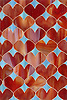 Hearts, a glass waterjet mosaic  shown in Garnet and George, is part of the Erin Adams Collection for New Ravenna.