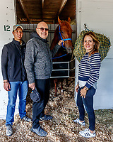 LOUISVILLE, KENTUCKY - MAY 02: Majority owner Salomón Del Valle (C), his daughter Veronica Del Valle (R) and Alex Sano (L), son of trainer Antonio Sano (not pictured), pose for a photo with Gunnevera at Churchill Downs on May 2, 2017 in Louisville, Kentucky. (Photo by Jesse Caris/Eclipse Sportswire/Getty Images)