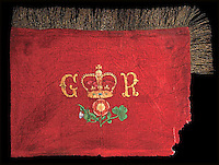 BNPS.co.uk (01202 558833)<br /> Pic: Mullocks/BNPS<br /> <br /> ***Please use full byline***<br /> <br /> A flag that is believed to have been flown at the Battle of Waterloo has emerged for sale among a collection of memorabilia relating to the Duke of Wellington.<br /> <br /> The crimson battle standard of the Royal Horse Guards is framed and has a crown motif between the letters 'GR', the Royal cypher.<br /> <br /> It also has the rose of England, thistle of Scotland and shamrock of Ireland and comes in a frame with an inscription stating 'carried at the Battle of Waterloo 1815'.<br /> <br /> The flag, which measures 37 by 23 inches and has gold wire embellishments, has a pre-sale estimate of &pound;10,000.