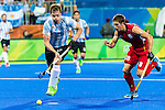 Lucas Rossi #27 of Argentina moves to the ball while Jerome Truyens #28 of Belgium chases during Argentina vs Belgium  in the men's gold medal game at the Rio 2016 Olympics at the Olympic Hockey Centre in Rio de Janeiro, Brazil.