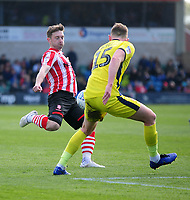 Lincoln City's Lee Frecklington gets a shot away under pressure from Cheltenham Town's William Boyle<br /> <br /> Photographer Andrew Vaughan/CameraSport<br /> <br /> The EFL Sky Bet League Two - Lincoln City v Cheltenham Town - Saturday 13th April 2019 - Sincil Bank - Lincoln<br /> <br /> World Copyright &copy; 2019 CameraSport. All rights reserved. 43 Linden Ave. Countesthorpe. Leicester. England. LE8 5PG - Tel: +44 (0) 116 277 4147 - admin@camerasport.com - www.camerasport.com