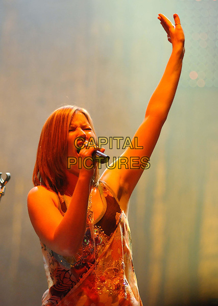 DIDO.Performs live at The Wiltern LG Theatre during her 'Life for Rent' Tour, Los Angeles, California..May 25th 2004.half length half-length music singing gig concert on stage arm up gesture fingers.Ref: EAS.www.capitalpictures.com.sales@capitalpictures.com.©Capital Pictures