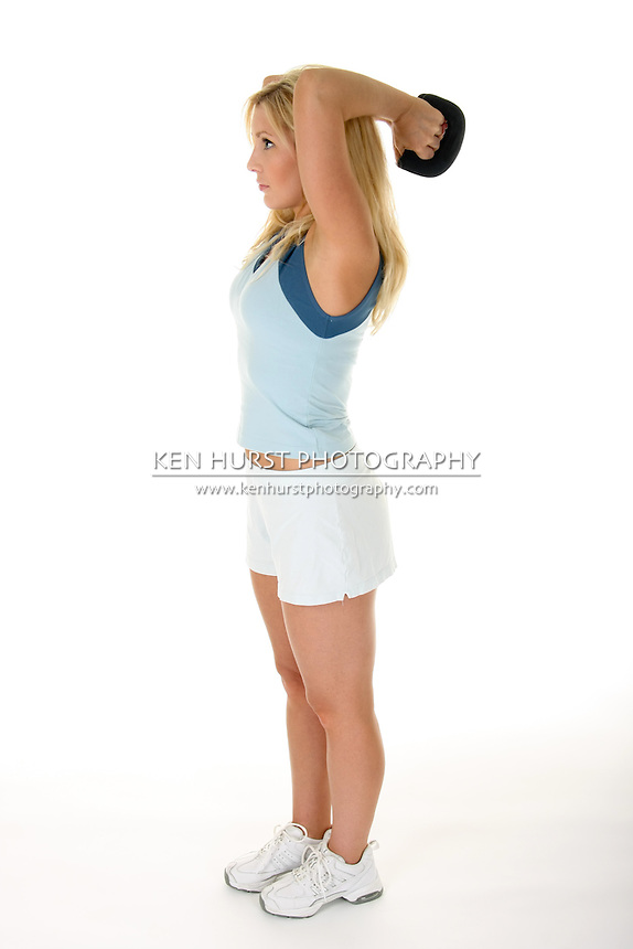 Beautiful blonde woman exercising with handweights.