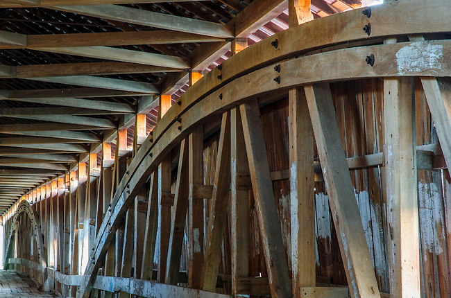 The West Union Covered Bridge interior shows the builders design.  The bridge is one of the longer covered bridges at 315 feet and crosses Sugar Creek in parke County, Indiana