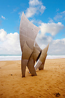 """the Brave Men' scupture in the sand at Omaha D Day landing beach, Normandy, France."