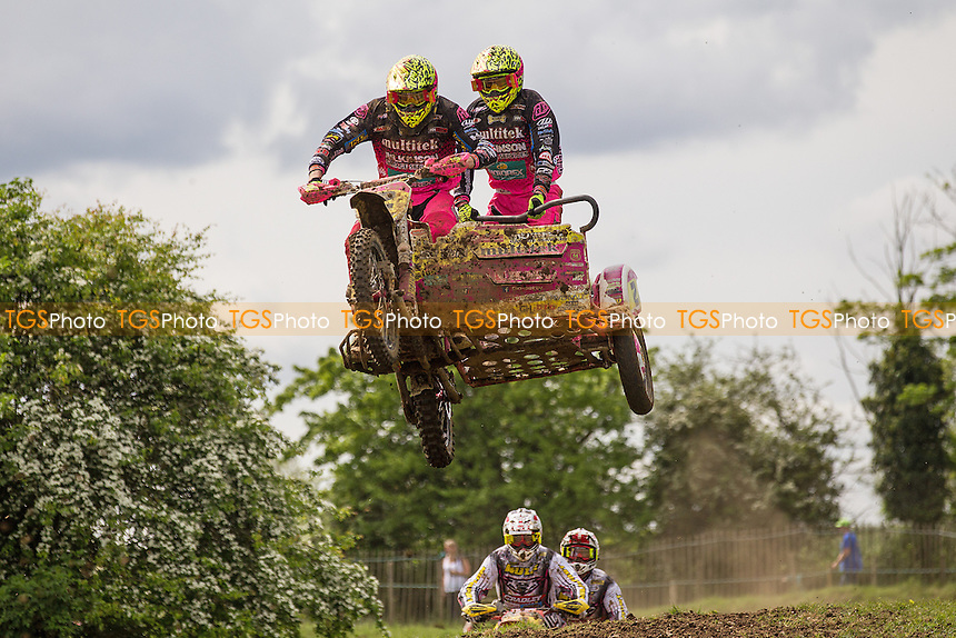 Brett Wilkinson and Steve Kirwin hot on the heels of the early race leaders in moto 1 during ACU British Sidecar Cross Championship Round Three at Wattisfield Hall MX Track on 22nd May 2016