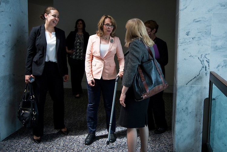 UNITED STATES - MAY 1: Former Rep. Gabrielle Giffords, D-Ariz., arrives on the 7th floor of the Hart Senate Office Building for her meeting with Sen. Richard Blumenthal, D-Conn., and Sen. Chris Murphy, D-Conn., to discuss Congressional efforts to curb gun violence and domestic violence on May 1, 2014. (Photo By Bill Clark/CQ Roll Call)