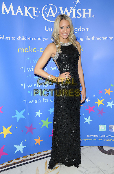 Jenna Randall.attended the Make-A-Wish Winter Ball, Dorchester Hotel, Park Lane, London, England, UK, 24th November 2012..full length black dress long maxi hand on hip sleeveless sequined sequin paillettes .CAP/CAN.©Can Nguyen/Capital Pictures.