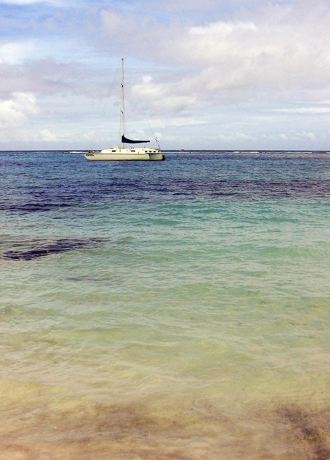 Sailboat anchored in bay in Caribbean