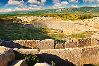 Mycenae Grave Circle A. A 16th century BC royal cemetery containing six shaft graves, where a total of nineteen bodies were buried among the objects found were a series of gold death masks including Agamemnons. Excavated by the archaeologist Heinrich Schliemann in 1876, following the descriptions of Homer and Pausanias.  Mycenae UNESCO World Heritage  Archaeological Site, Peloponnese, Greece