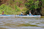 Tourists Canoeing On Zambezi River