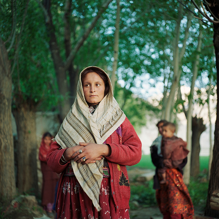 A Wakhi woman stands with her family in the village of Ghaz Khan. The Wakhan Corridor and the surrounding province of Badakshan have one of the highest maternal mortality rates in the world.