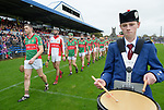 The Clooney-Quin team marching behind the Tulla Pipe band before their senior county final against Sixmilebridge at Cusack Park. Photograph by John Kelly.