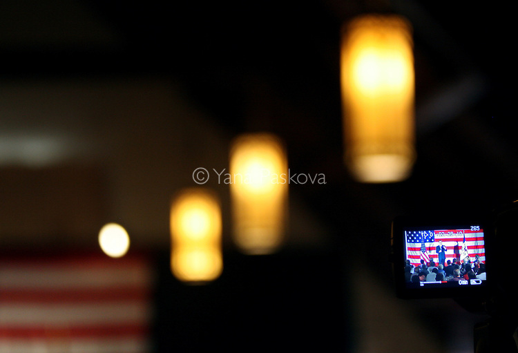A news video camera records as Republican presidential hopeful and former Massachusetts Governor Mitt Romney addresses supporters during a campaign stop at Simpson College in Indianola, Iowa June 30, 2007.