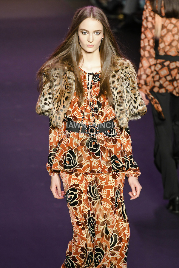 Zuzanna Bijoch walks runway in an outfit from the Anna Sui Fall 2011 collection, during Mercedes-Benz Fashion Week Fall 2011.