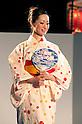 July 27 2012, Tokyo, Japan  The finalist Wakana Akanuma shows her dress at Yukata Beauty Contest in Koichi Festival. Shoko Kondo, one of the 10 finalists of 270 candidates, wins the annual Yukata Beauty Festival at Koichi Festival in Shimbashi, Tokyo. (Photo by Rodrigo Reyes Marin/AFLO)..