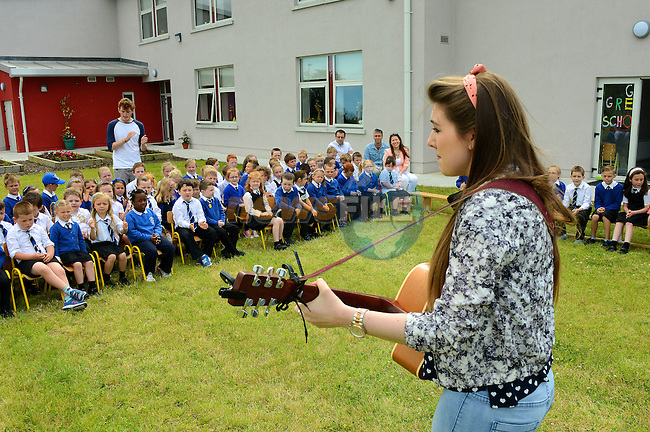Katy Anna Mohan singing for the children of St. Joseph's School, Ballymakenny Road at their green flag ceremony.