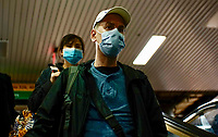 NEW YORK, NEW YORK - MARCH 03 : People wear face masks inside the Port Authority in New York on March 03, 2020. New York confirms second coronavirus case, as flights cancelations and Jewish schools close over virus fears.The first person to test positive for coronavirus in the state is a 39-year-old health-care worker who arrived from Iran with her husband, the second one is an attorney who lives in Westchester County, works in Manhattan, Gov. Andrew Cuomo said. (Photo by Eduardo Munoz / VIEWpress via Getty Images)