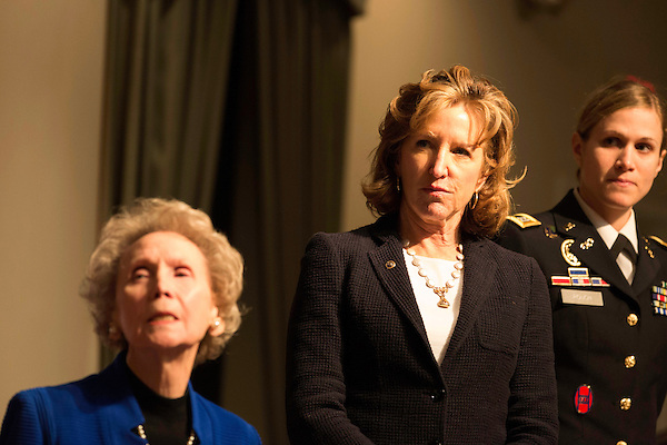 """April 16, 2014. Durham, North Carolina.<br />  Senator Kay Hagan, center. Hagan has been largely absent from the campaign trail even as several Republican challengers have mounted campaigns to defeat her in this year's election.<br />  Kay Hagan (D),  US Senator from North Carolina, attended an event to honor the military service of Donald """"Buddy"""" Moore, Hagan awarded Moore's widow Wanda a posthumous Bronze Star, as well as several other medals, for his service in World War II."""