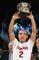 Stanford's Aaron Bright (2) holds up the MVP trophy after defeating Minnesota 75-51 in championship game of the NIT at Madison Square Garden, New York, N.Y., Wednesday, March 29, 2012. (Rich Schultz/isiphotos.com)