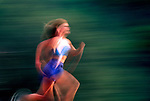 Pan of a woman running