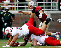 TALLAHASSEE, FL 10/31/09-FSU-NCST FB09 CH42-N.C. State's Natanu Mageo fumbles the pass he just intercepted from Christian Ponder, right, as Jarmon Fortson, below, recovers the ball during second half action Saturday at Doak Campbell Stadium in Tallahassee. The Seminoles beat the Wolf Pack 45-42..COLIN HACKLEY PHOTO