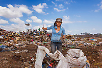 Angela, Trash-Picker, Granada, Nicaragua, 2012<br /> Women who are widowed or abandoned by their husbands and fathers are left with little recourse to care for their families in Nicaragua. These single women and young girls sort through one of the largest garbage dumps in Central America, searching for recycling that will bring them a dollar a day as a means to support their families.