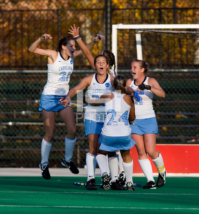 Meghan Dawson (21), Caitlin Van Sickle (20), Marta Malmberg (24), and Elizabeth Drazdowski (18) celebrate the game-winning goal during the NCAA Field Hockey Championship semfinals in College Park, MD.  North Carolina defeated Virginia, 4-3, in overtime.