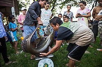 Oct. 14, 2016 - Don Sahong, Laos. Villagers gather to see a fisherman's large catch that he brought in from his nets in the early morning. © Nicolas Axelrod / Ruom