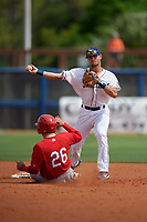Charlotte Stone Crabs second baseman Jim Haley (20) throws to first base as Alexis Wilson (26) slides in during a Florida State League game against the Palm Beach Cardinals on April 14, 2019 at Charlotte Sports Park in Port Charlotte, Florida.  Palm Beach defeated Charlotte 5-3.  (Mike Janes/Four Seam Images)