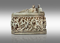 "Roman relief sculpted sarcophagus depicting a scene with Dionysus made in a Greek Attica workshop, 3rd century AD, Perge Inv 1.35.99. Antalya Archaeology Museum, Turkey.<br /> <br /> The lid of the sarcophagus is sculpted into the form of a ""Kline"" style Roman couch on which lie Julianus &  Philiska. This type of Sarcophagus is also known as a Sydemara Type of Tomb.. Against a grey background."