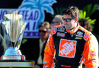 Nov. 16, 2008; Homestead, FL, USA; NASCAR Sprint Cup Series former champion Tony Stewart walks by the championship trophy during the Ford 400 at Homestead Miami Speedway. Mandatory Credit: Mark J. Rebilas-