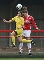 Jennifer Beattie of Arsenal heads clear from Lucie Kladrubska - Arsenal Ladies vs Sparta Prague - UEFA Women's Champions League at Boreham Wood FC - 11/11/09 - MANDATORY CREDIT: Gavin Ellis/TGSPHOTO - Self billing applies where appropriate - Tel: 0845 094 6026